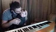 tatal-si-bebe-la-pian